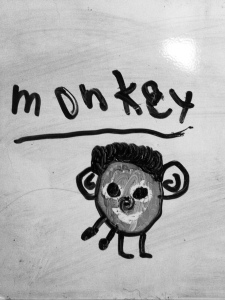 This is a monkey my son drew. Too bad the one that's sitting on me isn't cute like this one.