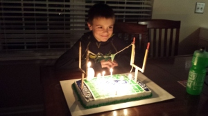 My behbeh with his Seattle Seahawks cake, complete with goal posts made by his big brother.