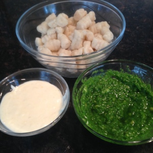 Gnocchi with garlic butter cream sauce and pesto