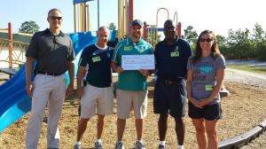 Presenting the $7800 check to the UNCW running coaches. They were floored.