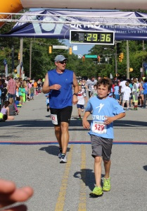 My son and his dad as the running buddy. We started two minutes after the clock did, so pulling down a 27:00 5k when you're 9 is pretty darned awesome.