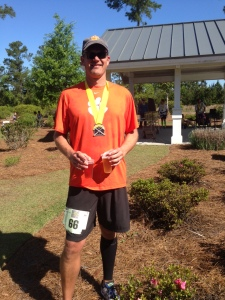 The Hubster with his medal and beer. Turns out he got first in his age group too. BONUS TROPHY!