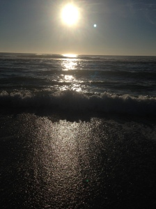 The sun rise over the ocean the day I got to swim in the ocean while the sun rose.